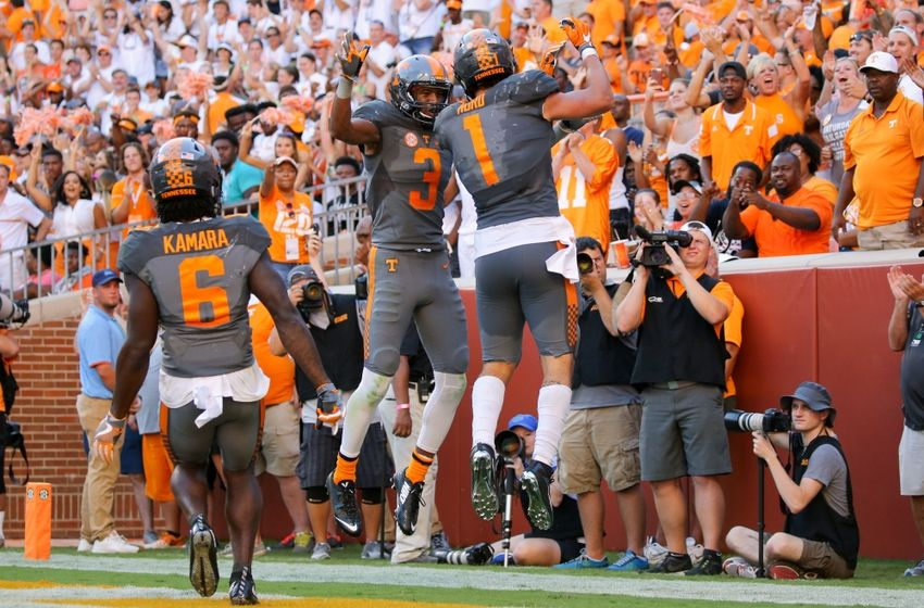 Sep 24, 2016; Knoxville, TN, USA; Tennessee Volunteers running back Jalen Hurd (1) and Tennessee Volunteers wide receiver Josh Malone (3) celebrate after Hurd scored a touchdown against the Florida Gators during the second quarter at Neyland Stadium. Mandatory Credit: Randy Sartin-USA TODAY Sports
