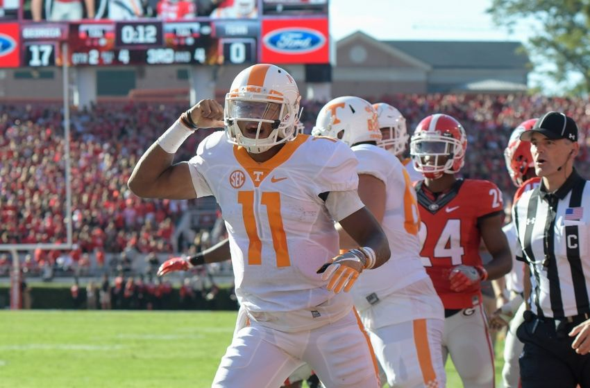 Oct 1, 2016; Athens, GA, USA; Tennessee Volunteers quarterback Joshua Dobbs (11) reacts after scoring a touchdown against the Georgia Bulldogs during the second quarter at Sanford Stadium. Mandatory Credit: Dale Zanine-USA TODAY Sports