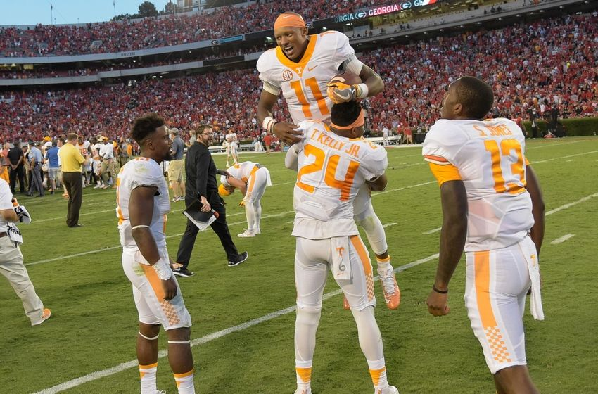 Oct 1, 2016; Athens, GA, USA; Tennessee Volunteers quarterback Joshua Dobbs (11) is lifted in the air by defensive back Todd Kelly Jr. (24) after throwing the winning touchdown pass on the last play on the game against the Georgia Bulldogs during the fourth quarter at Sanford Stadium. Tennessee defeated Georgia 34-31. Mandatory Credit: Dale Zanine-USA TODAY Sports