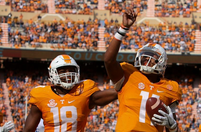 Nov 12, 2016; Knoxville, TN, USA; Tennessee Volunteers tight end Jason Croom (18) congratulates Tennessee Volunteers quarterback Joshua Dobbs (11) after Hobbs scored a touchdown against the Kentucky Wildcats during the first half at Neyland Stadium. Mandatory Credit: Randy Sartin-USA TODAY Sports