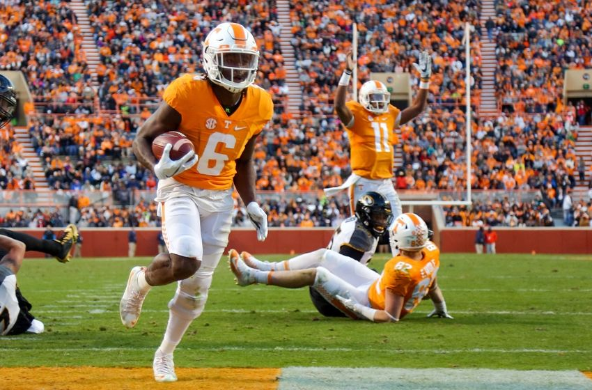 Nov 19, 2016; Knoxville, TN, USA; Tennessee Volunteers quarterback Joshua Dobbs (11) signals a touchdown as Tennessee Volunteers running back Alvin Kamara (6) scores against the Missouri Tigers during the second quarter at Neyland Stadium. Mandatory Credit: Randy Sartin-USA TODAY Sports