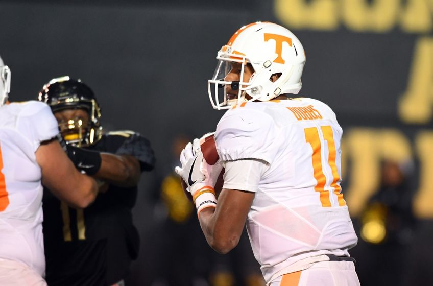 Nov 26, 2016; Nashville, TN, USA; Tennessee Volunteers quarterback Joshua Dobbs (11) drops back to pass during the first half against the Vanderbilt Commodores at Vanderbilt Stadium. Mandatory Credit: Christopher Hanewinckel-USA TODAY Sports