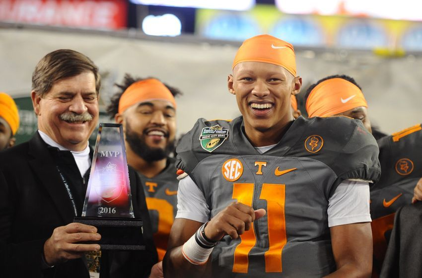 Dec 30, 2016; Nashville , TN, USA; Tennessee Volunteers quarterback Joshua Dobbs (11) is awarded the Music City Bowl MVP trophy after a win over the Nebraska Cornhuskers at Nissan Stadium. Tennessee won 38-24.Mandatory Credit: Christopher Hanewinckel-USA TODAY Sports