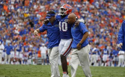 Oct 15, 2016; Gainesville, FL, USA; Florida Gators linebacker Jarrad Davis (40) is helped off the field after an apparent injury against the Missouri Tigers during the second half at Ben Hill Griffin Stadium. Florida Gators defeated the Missouri Tigers 40-14. Mandatory Credit: Kim Klement-USA TODAY Sports