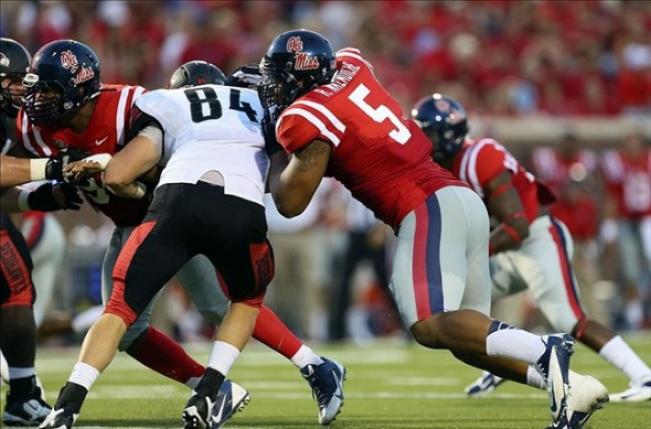 Mississippi Rebels defensive end Robert Nkemdiche (5) and Southeast Missouri State Redhawks wide receiver Art Mueller (84) fight for the line during the first half at Vaught-Hemingway Stadium. Mandatory Credit: Spruce Derden-USA TODAY Sports