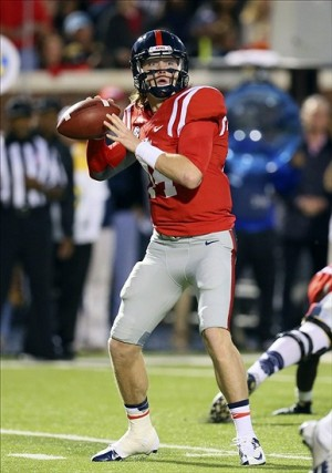 Oct 19, 2013; Oxford, MS, USA; Mississippi Rebels quarterback Bo Wallace (14) drops back for a pass during the game against the LSU Tigers at Vaught-Hemingway Stadium. Mandatory Credit: Spruce Derden-USA TODAY Sports