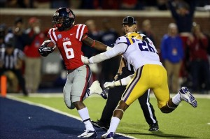 Oct 19, 2013; Oxford, MS, USA; Mississippi Rebels running back Jaylen Walton (6) advances the ball for a touchdown during the game against the LSU Tigers at Vaught-Hemingway Stadium. Mississippi Rebels defeat the LSU Tigers 27-24. Mandatory Credit: Spruce Derden-USA TODAY Sports