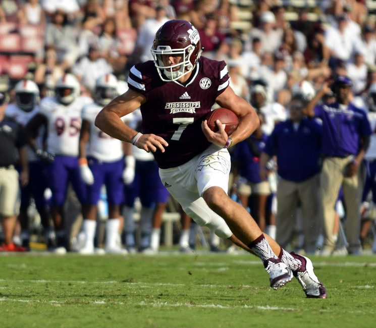 Sep 19, 2015; Starkville, MS, USA; Mississippi State Bulldogs quarterback Nick Fitzgerald (7) runs the ball during the second half of the game against the Northwestern State Demons at Davis Wade Stadium. Mississippi State won 62-13. Mandatory Credit: Matt Bush-USA TODAY Sports