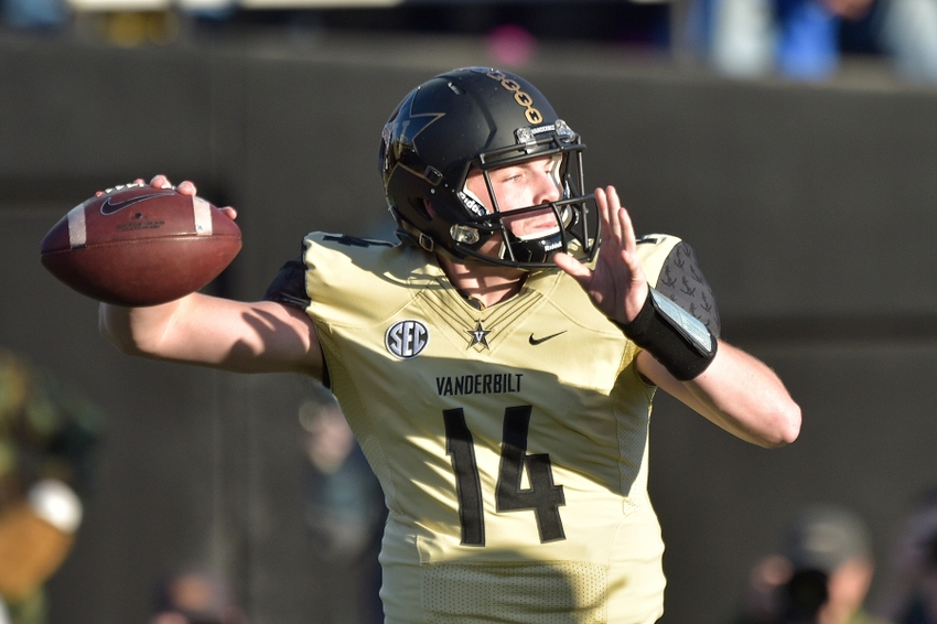 Nov 14, 2015; Nashville, TN, USA; Vanderbilt Commodores quarterback Kyle Shurmur (14) passes against the Kentucky Wildcats during the first half at Vanderbilt Stadium. Mandatory Credit: Jim Brown-USA TODAY Sports