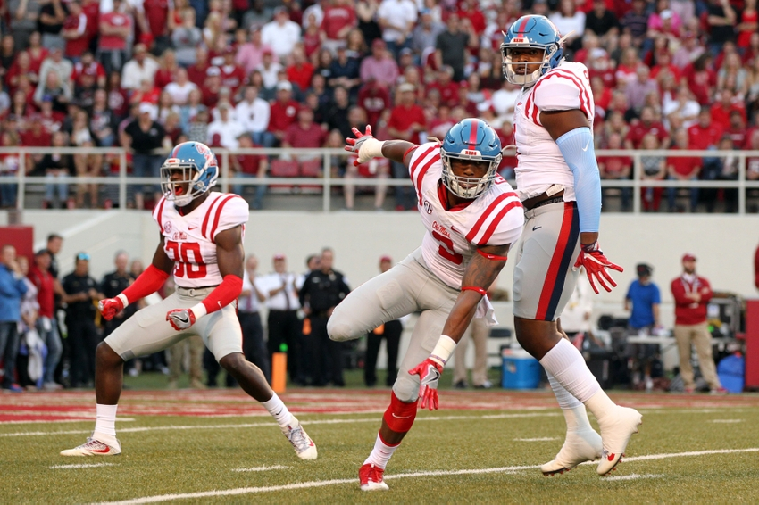 Oct 15, 2016; Fayetteville, AR, USA; Ole Miss Rebels defensive back A.J. Moore (30) linebacker DeMarquis Gates (3) and defensive tackle Breeland Speaks (9) celebrate after a sack by Gates in the first quarter against the Arkansas Razorbacks at Donald W. Reynolds Razorback Stadium. Mandatory Credit: Nelson Chenault-USA TODAY Sports