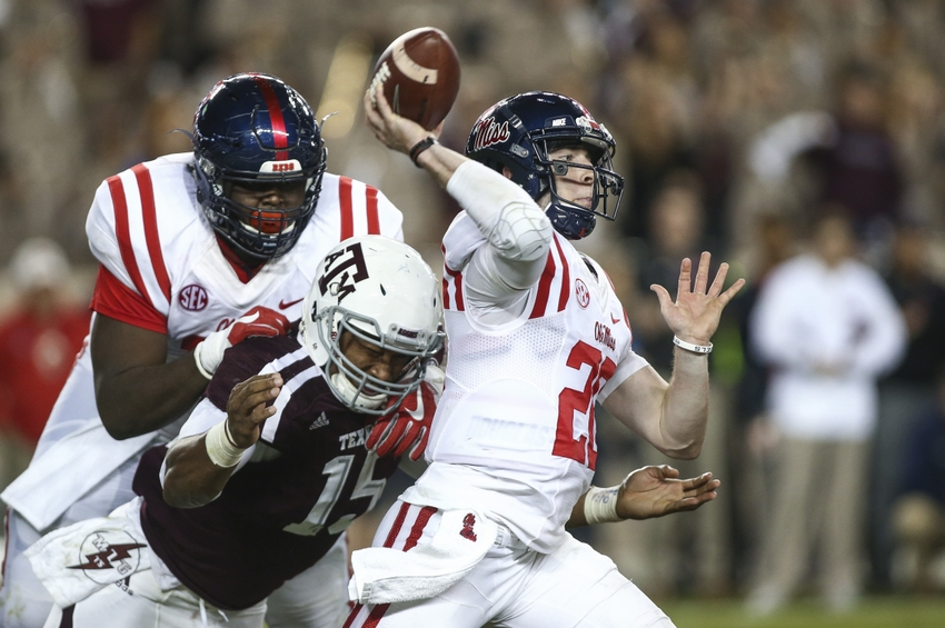 Nov 12, 2016; College Station, TX, USA; Texas A&M Aggies defensive lineman Myles Garrett (15) attempts to sack Mississippi Rebels quarterback Shea Patterson (20) during the second quarter at Kyle Field. Mandatory Credit: Troy Taormina-USA TODAY Sports