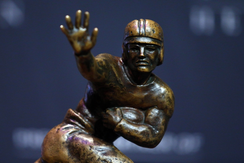 Dec 13, 2014; New York, NY, USA; Detail of the Heisman Trophy as it sits on a pedestal before the pre-announcement press conference at the New York Marriott Marquis. Mandatory Credit: Brad Penner-USA TODAY Sports