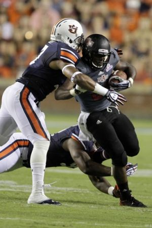 Sep 7, 2013; Auburn, AL, USA; Auburn Tigers linebacker Kris Frost (17) tackles Arkansas State Red Wolves running back David Oku (25) during the first half at Jordan Hare Stadium. Mandatory Credit: John Reed-USA TODAY Sports