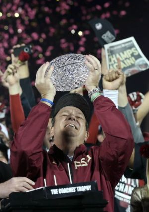 Jan 6, 2014; Pasadena, CA, USA; Florida State Seminoles head coach Jimbo Fisher celebrates as he hoists the trophy after defeating the Auburn Tigers 34-31 the 2014 BCS National Championship game at the Rose Bowl. Mandatory Credit: Matthew Emmons-USA TODAY Sports