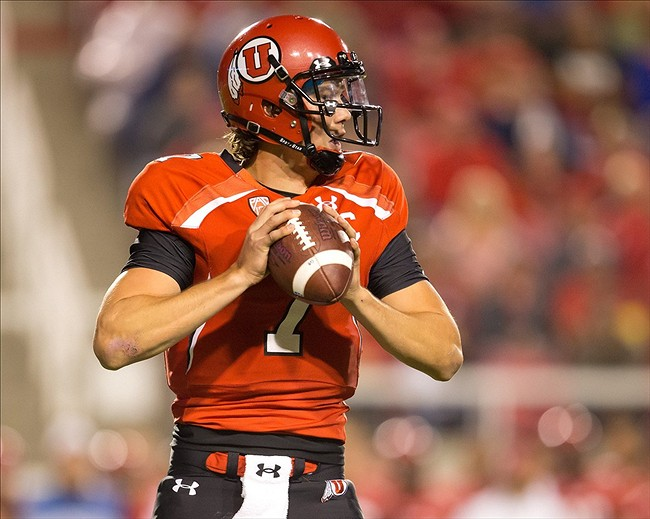 Sep 14, 2013; Salt Lake City, UT, USA; Utah Utes quarterback Travis Wilson (7) drops back to pass during the first half against the Oregon State Beavers at Rice-Eccles Stadium. Mandatory Credit: Russ Isabella-USA TODAY Sports