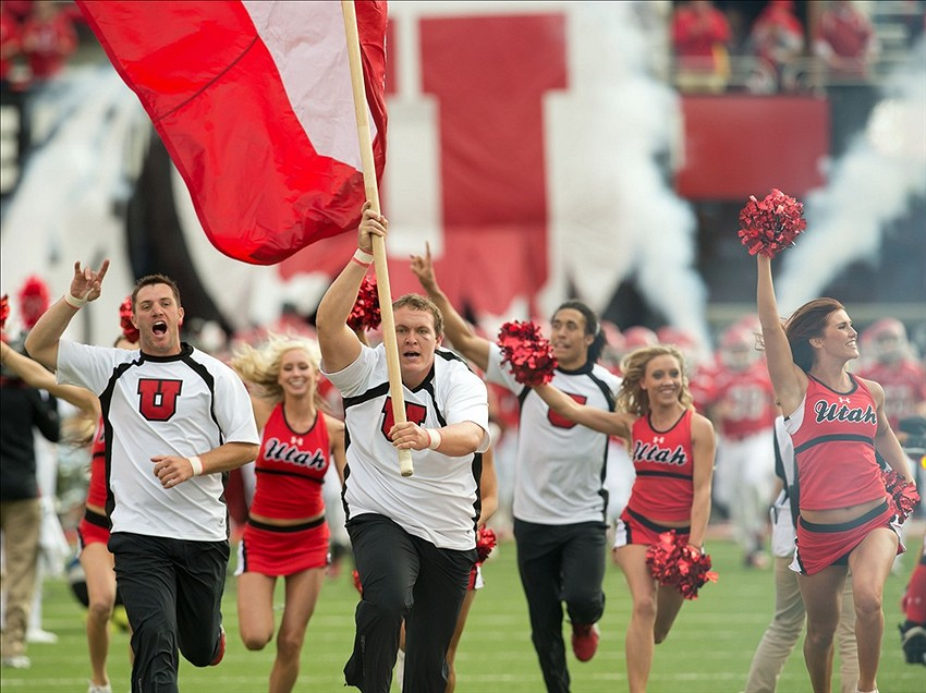 Oct 12, 2013 Salt Lake City, UT, USA; Utah Utes cheerleaders lead the team onto the field prior to a game against the Stanford Cardinal at Rice-Eccles Stadium. Utah defeated Stanford 27-21. Mandatory Credit: Russ Isabella-USA TODAY Sports