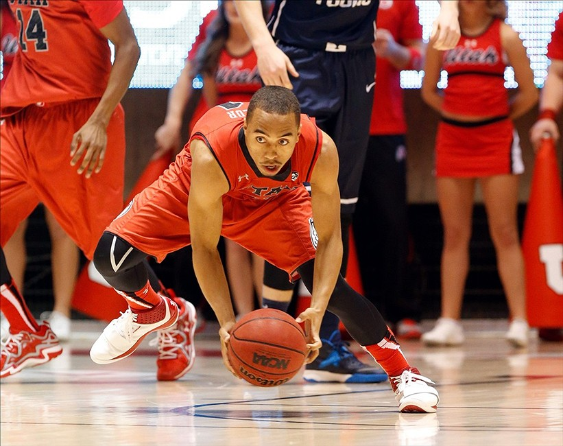 Dec 14, 2013; Salt Lake City, UT, USA; Utah Utes guard Brandon Taylor (11) grabs a loose ball and heads up the court during the first half against the Brigham Young Cougars at Jon M. Huntsman Center. Mandatory Credit: Chris Nicoll-USA TODAY Sports