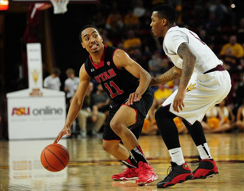 Jan 23, 2014; Tempe, AZ, USA; Utah Utes guard Brandon Taylor (11) dribbles the ball as Arizona State Sun Devils guard Jahii Carson (1) defends during the second half against the Arizona State Sun Devils at Wells Fargo Arena. Mandatory Credit: Jennifer Hilderbrand-USA TODAY Sports