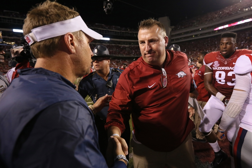 9609972-bret-bielema-hugh-freeze-ncaa-football-mississippi-arkansas