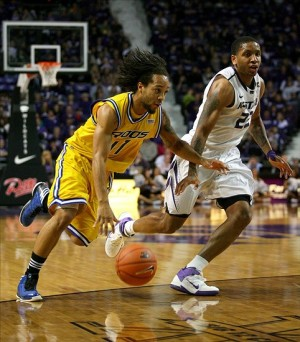 Kangaroos guard Estan Tyler drives by Rodney McGruder. (Photo Credit: Scott Sewell-USA TODAY Sports)