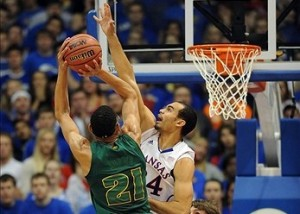 January 14, 2013; Lawrence, KS, USA; Baylor Bears center Isaiah Austin (21) has his shot blocked by Kansas Jayhawks forward Perry Ellis (34) in the first half at Allen Fieldhouse. Mandatory Credit: Denny Medley-USA TODAY Sports
