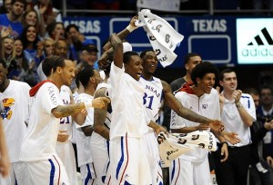 Feb 16, 2013; Lawrence, KS, USA; The Kansas Jayhawks bench celebrates after a basket against the Texas Longhorns in the second half at Allen Fieldhouse. Kansas won the game 73-47. Mandatory Credit: John Rieger-USA TODAY Sports