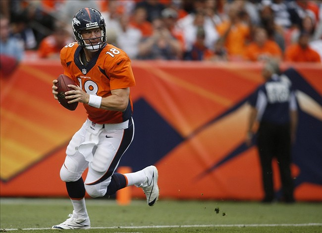 Aug 24, 2013; Denver, CO, USA; Denver Broncos quarterback Peyton Manning (18) looks to pass the ball during the first half against the St. Louis Rams at Sports Authority Field at Mile High. Mandatory Credit: Chris Humphreys-USA TODAY Sports