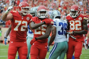 Sep 15, 2013; Kansas City, MO, USA; Kansas City Chiefs running back Jamaal Charles (25) is congratulated by offensive tackle Eric Fisher (72) after scoring a touchdown against the Dallas Cowboys in the first half at Arrowhead Stadium. Mandatory Credit: John Rieger-USA TODAY Sports
