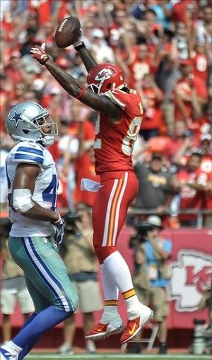 Sep 15, 2013; Kansas City, MO, USA; Kansas City Chiefs wide receiver Dwayne Bowe (82) celebrates after scoring a touchdown during the second half of the game against the Dallas Cowboys at Arrowhead Stadium. The Chiefs won 17-16. Mandatory Credit: Denny Medley-USA TODAY Sports