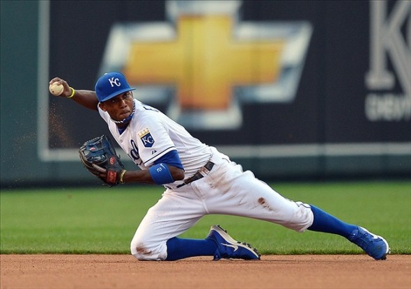 June 25, 2013; Kansas City, MO, USA; Kansas City Royals shortstop Alcides Escobar (2) makes a throw to second for an out from his knees against the Atlanta Braves during the fourth inning at Kauffman Stadium. Mandatory Credit: Peter G. Aiken-USA TODAY Sports