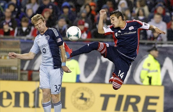 Revolution forward Diego Fagundez (14) controls the ball as Sporting KC forward Jacob Peterson (37) defends during the second half of the Eastern Conference Semifinals at Gillette Stadium. (Stew Milne, USA TODAY Sports)