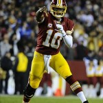 Dec 1, 2013; Landover, MD, USA; Washington Redskins quarterback Robert Griffin III (10) throws the ball against the New York Giants during the first half at FedEx Field. Mandatory Credit: Brad Mills-USA TODAY Sports