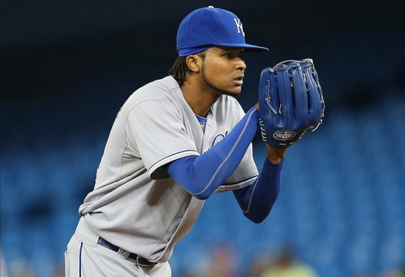 Aug 30, 2013; Toronto, Ontario, CAN; Kansas City Royals starting pitcher Ervin Santana (54) looks in before delivering a pitch against the Toronto Blue Jays at Rogers Centre. The Blue Jays beat the Royals 3-2. Mandatory Credit: Tom Szczerbowski-USA TODAY Sports