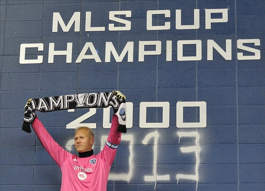 Dec 7, 2013; Kansas City, KS, USA; Sporting KC goalkeeper Jimmy Nielsen (1) celebrates after spray painting the wall after the 2013 MLS Cup against the Real Salt Lake at Sporting Park. Sporting KC won in a shootout. Mandatory Credit: Peter G. Aiken-USA TODAY Sports