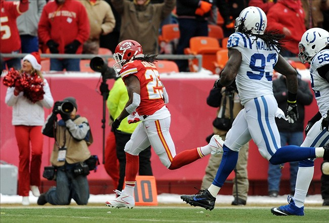 Dec 22, 2013; Kansas City, MO, USA; Kansas City Chiefs running back Jamaal Charles (25) runs in for a touchdown as Indianapolis Colts outside linebacker Erik Walden (93) and inside linebacker Kelvin Sheppard (52) cannot make the tackle during the first half at Arrowhead Stadium. Mandatory Credit: Denny Medley-USA TODAY Sports