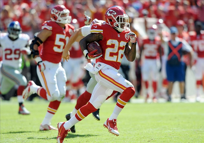 Sep 29, 2013; Kansas City, MO, USA; Kansas City Chiefs wide receiver Dexter McCluster (22) runs a punt back for a touchdown during the second half of the game against the New York Giants at Arrowhead Stadium. The Chiefs won 31-7. Mandatory Credit: Denny Medley-USA TODAY Sports