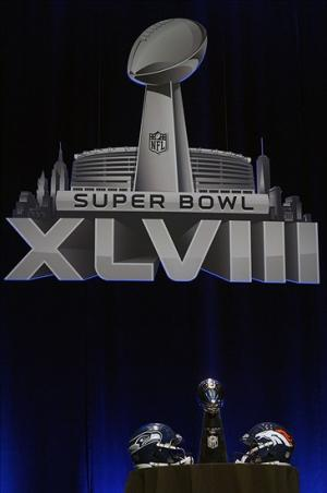 Jan 31, 2014; New York, NY, USA; Seattle Seahawks and Denver Broncos helmets are on display with the Vince Lombardi Trophy prior to a press conference at Rose Theater in advance of Super Bowl XLVIII. Mandatory Credit: Joe Camporeale-USA TODAY Sports