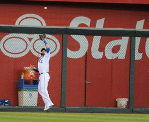 Kansas City Royals left fielder Alex Gordon (4) makes a catch at Kauffman Stadium. Mandatory Credit: Denny Medley-USA TODAY Sports
