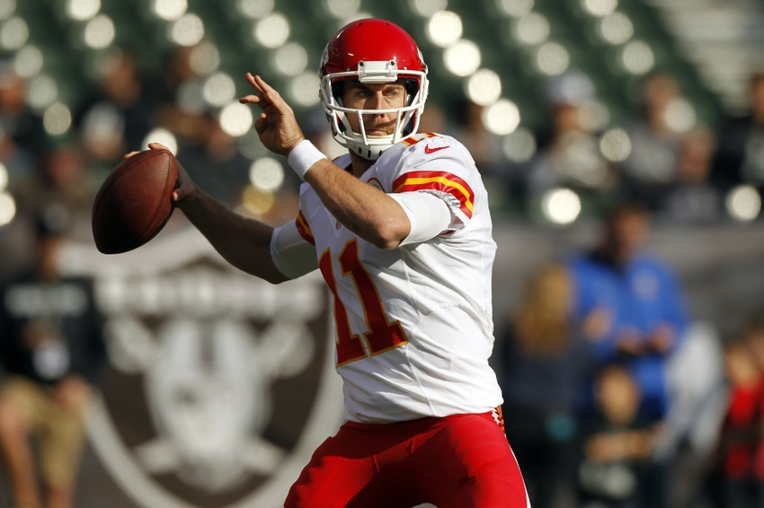 Dec 15, 2013; Oakland, CA, USA; Kansas City Chiefs quarterback Alex Smith (11) throws a pass before the start of the game against the Oakland Raiders at O.co Coliseum. Mandatory Credit: Cary Edmondson-USA TODAY Sports