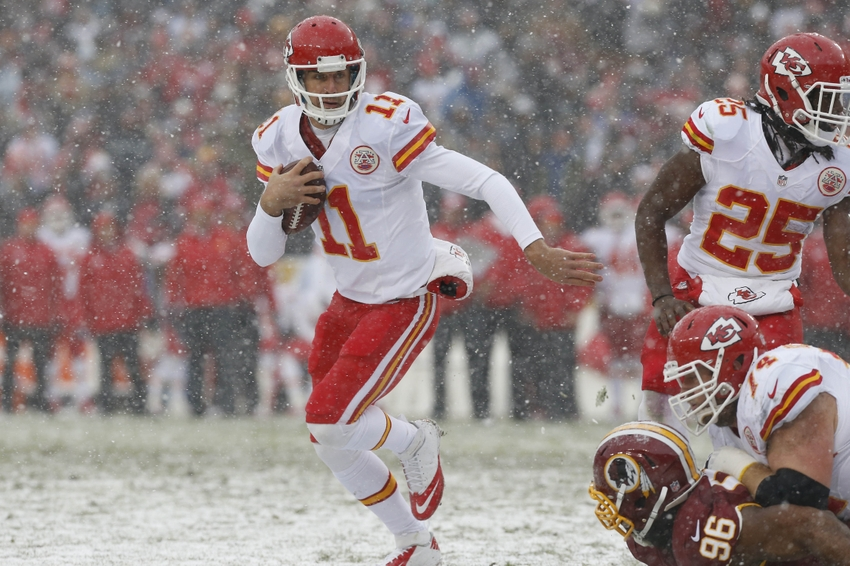 Dec 8, 2013; Landover, MD, USA; Kansas City Chiefs quarterback Alex Smith (11) runs with the ball against the Washington Redskins in the first quarter at FedEx Field. Mandatory Credit: Geoff Burke-USA TODAY Sports