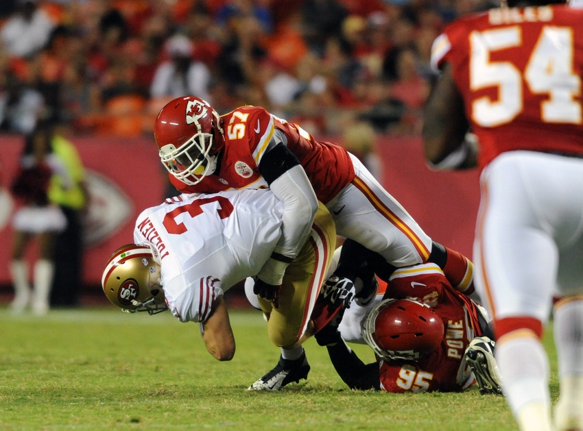 Aug 16, 2013; Kansas City, MO, USA; San Francisco 49ers quarterback Scott Tolzien (3) is sacked by Kansas City Chiefs inside linebacker Nico Johnson (57) during the second half at Arrowhead Stadium. San Francisco won 15-13. Mandatory Credit: Denny Medley-USA TODAY Sports
