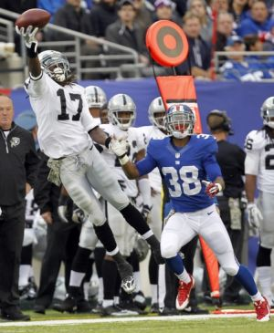 Nov 10, 2013; East Rutherford, NJ, USA; Oakland Raiders wide receiver Denarius Moore (17) can