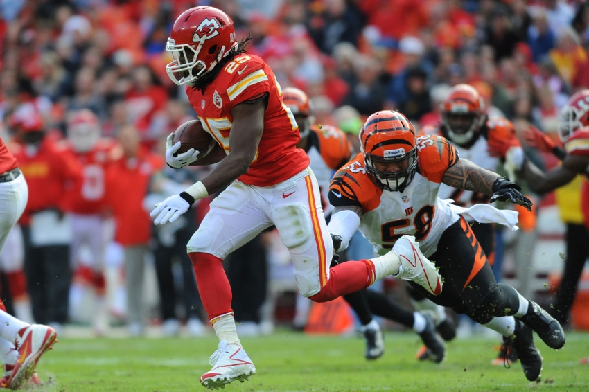 November 18, 2012; Kansas City, MO, USA; Kansas City Chiefs running back Jamaal Charles (25) runs the ball as Cincinnati Bengals middle linebacker Rey Maualuga (58) attempts the tackle in the second half at Arrowhead Stadium. The Bengals won 28-6. Mandatory Credit: Denny Medley-USA TODAY Sports