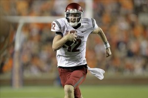 Aug 31, 2013; Auburn, AL, USA; Washington State Cougars quarterback Connor Halliday (12) carries against the Auburn Tigers at Jordan Hare Stadium. The Tigers beat the Cougars 31-24. Mandatory Credit: John Reed-USA TODAY Sports