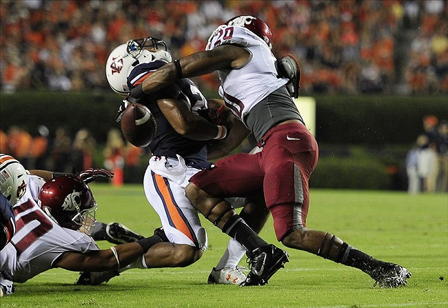 Aug 31, 2013; Auburn, AL, USA; Auburn Tigers running back Tre Mason (21) is tackled by Washington State Cougars safety Deone Bucannon (20) at Jordan Hare Stadium. The Tigers defeated the Cougars 31-24. Mandatory Credit: Shanna Lockwood-USA TODAY Sports