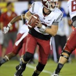 September 7, 2013; Los Angeles, CA, USA; Washington State Cougars quarterback Connor Halliday (12) rolls out to pass against the Southern California Trojans during the first half at the Los Angeles Memorial Coliseum. Mandatory Credit: Gary A. Vasquez-USA TODAY Sports