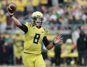 Sep 14, 2013; Eugene, OR, USA; Oregon Ducks quarterback Marcus Mariota (8) throws the ball in the second half against the Tennessee Volunteers at Autzen Stadium. Mandatory Credit: Scott Olmos-USA TODAY Sports
