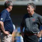 Oct 5, 2013; Berkeley, CA, USA; Washington State Cougars coach Mike Leach (right) and California Golden Bears coach Sonny Dykes before the game at Memorial Stadium. Mandatory Credit: Kirby Lee-USA TODAY Sports