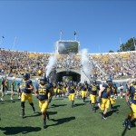Oct 5, 2013; Berkeley, CA, USA; General view of California Golden Bears players as they run onto the field before the game against the Washington State Cougars at Memorial Stadium. Mandatory Credit: Kirby Lee-USA TODAY Sports