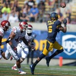Oct 5, 2013; Berkeley, CA, USA; California Golden Bears receiver Chris Harper (5) is defended by Washington State Cougars safety Taylor Taliulu (30) and lineacker Cyrus Coen (42) at Memorial Stadium. Mandatory Credit: Kirby Lee-USA TODAY Sports